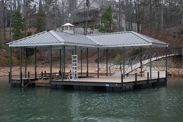 compound hip roof, cupola, weathervane, boat docks, swim ladder