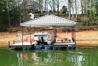 hydrohoist boatlift, single slip steel dock, hip roof, boat docks