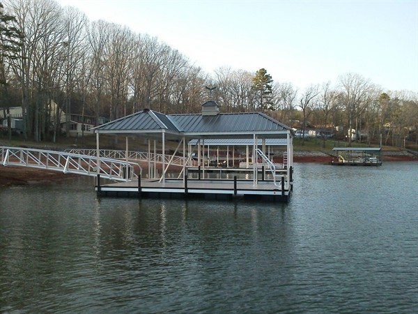 aluminum boat dock, compound hip roof, swim ladder, dock box