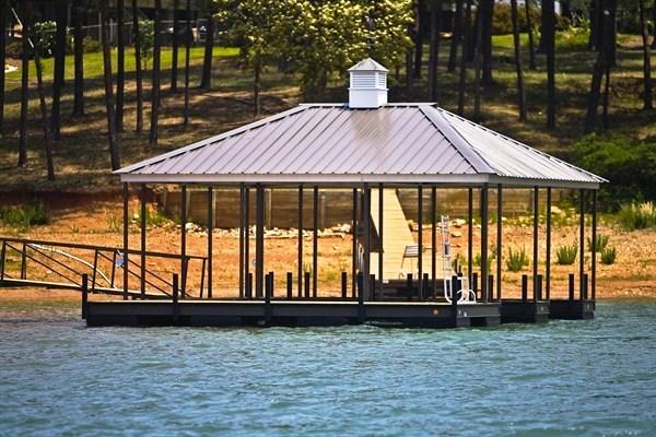 swim ladder, cupola, weathervane, hip roof, double slip dock