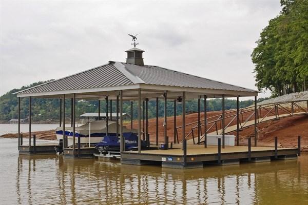arched walkway, dock storage, boat storage, dock box, cupola