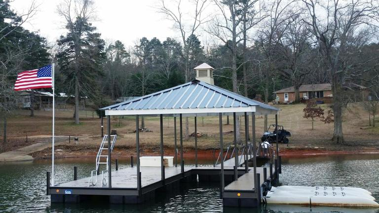 boat dock, american flag, flag pole, dock accessories