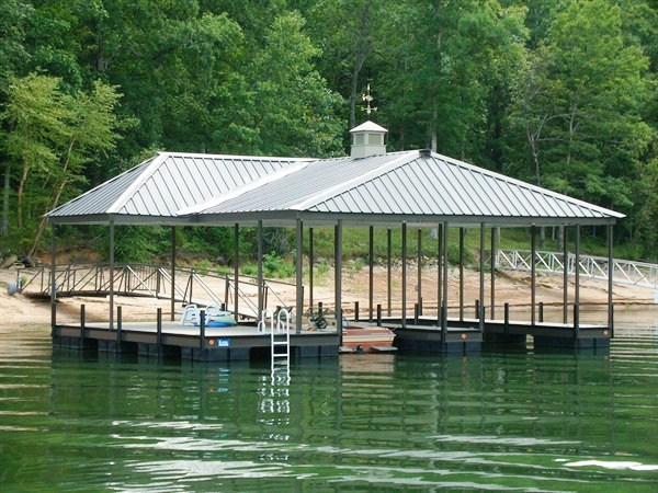 fascia colored roof, steel double slip dock with a hip roof