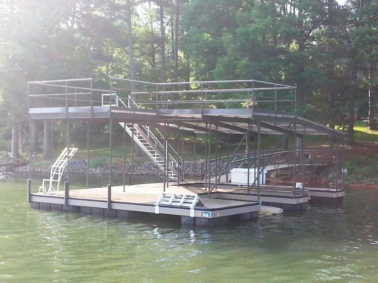 Steel boat docks, custom built boat dock, double slip boat dock, party deck boat dock