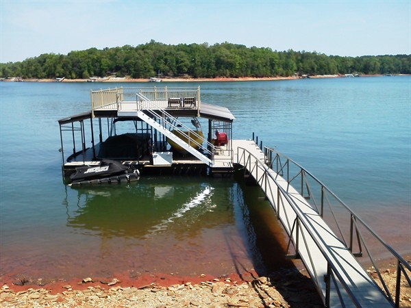 sundeck roof, two story dock, pwc lift, two slip dock