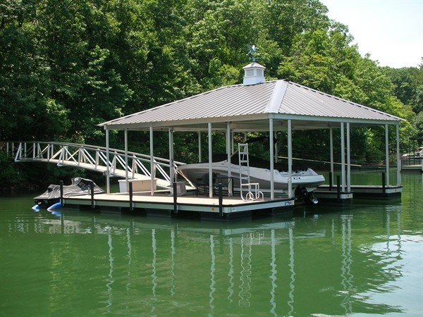 cupola, weather vane, arched walkway, boat lift, hip roof, docks