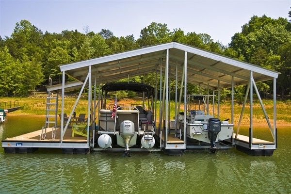 dock great for entertaining, extended gable roof, double slip, boat lifts