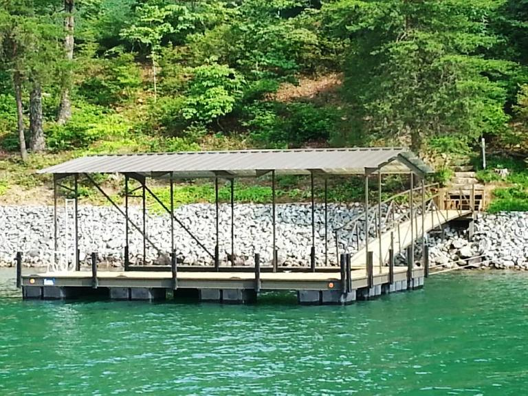 steel boat dock, gable roof, treated wood decking, aluminum swim ladder