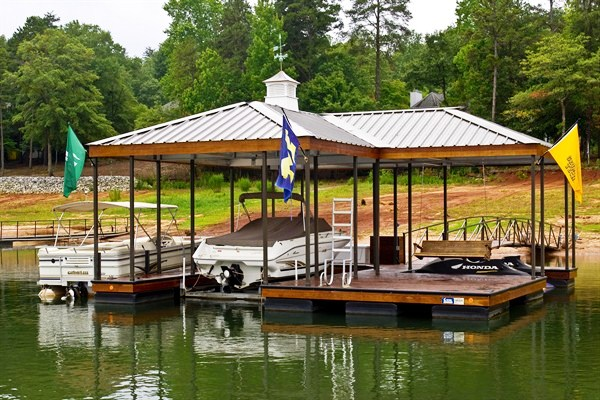 personal watercraft lift, lake living, boat house, arched walkway, dock accessories