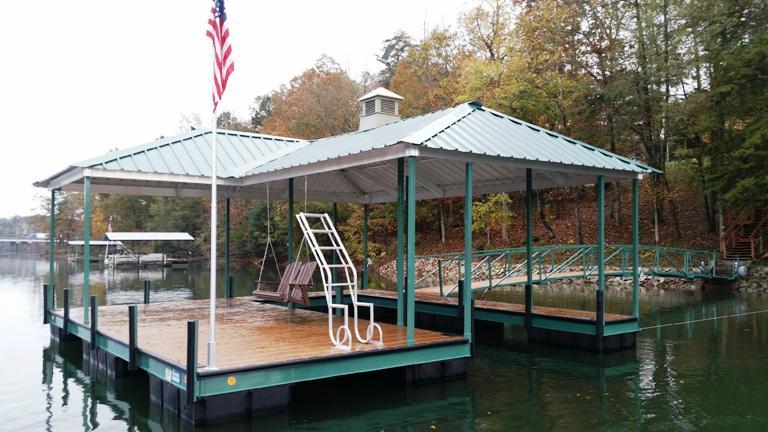green boat dock, hunter green, boat dock, lake living