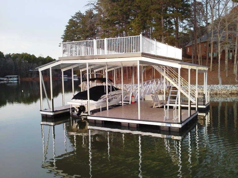 aluminum double slip dock with a party deck, custom built aluminum dock